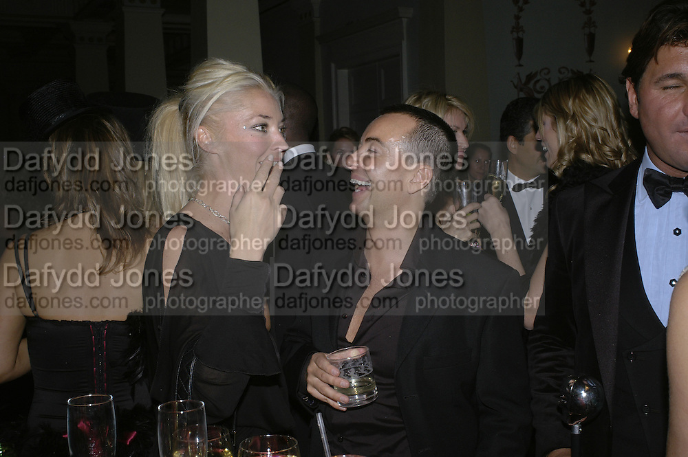 Tamara Beckwith and Julian Macdonald, Andy and Patti Wong's Chinese New Year of the Pig party. Madame Tussauds. ( Dress Burlesque, Debauched or Hollywood Black Tie. ) London. 27 January 2007.  -DO NOT ARCHIVE-© Copyright Photograph by Dafydd Jones. 248 Clapham Rd. London SW9 0PZ. Tel 0207 820 0771. www.dafjones.com.