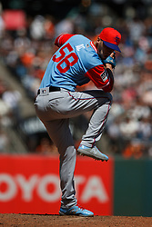 SAN FRANCISCO, CA - AUGUST 26: Alex Claudio #58 of the Texas Rangers pitches against the San Francisco Giants during the sixth inning at AT&T Park on August 26, 2018 in San Francisco, California. The San Francisco Giants defeated the Texas Rangers 3-1. All players across MLB will wear nicknames on their backs as well as colorful, non-traditional uniforms featuring alternate designs inspired by youth-league uniforms during Players Weekend. (Photo by Jason O. Watson/Getty Images) *** Local Caption *** Alex Claudio