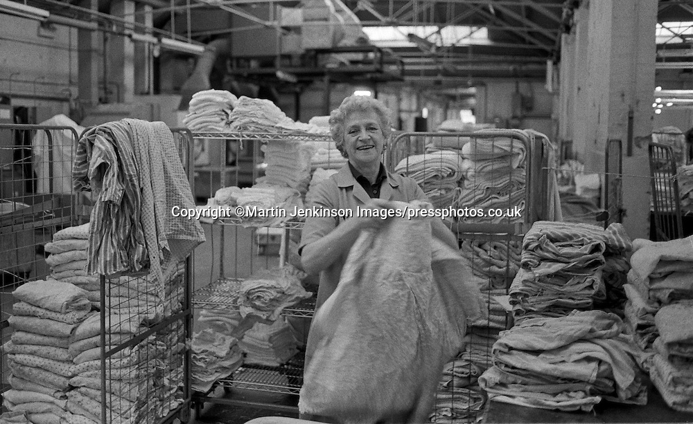 Female laundry worker Prestwich Hospital, Greater Manchester 1986.