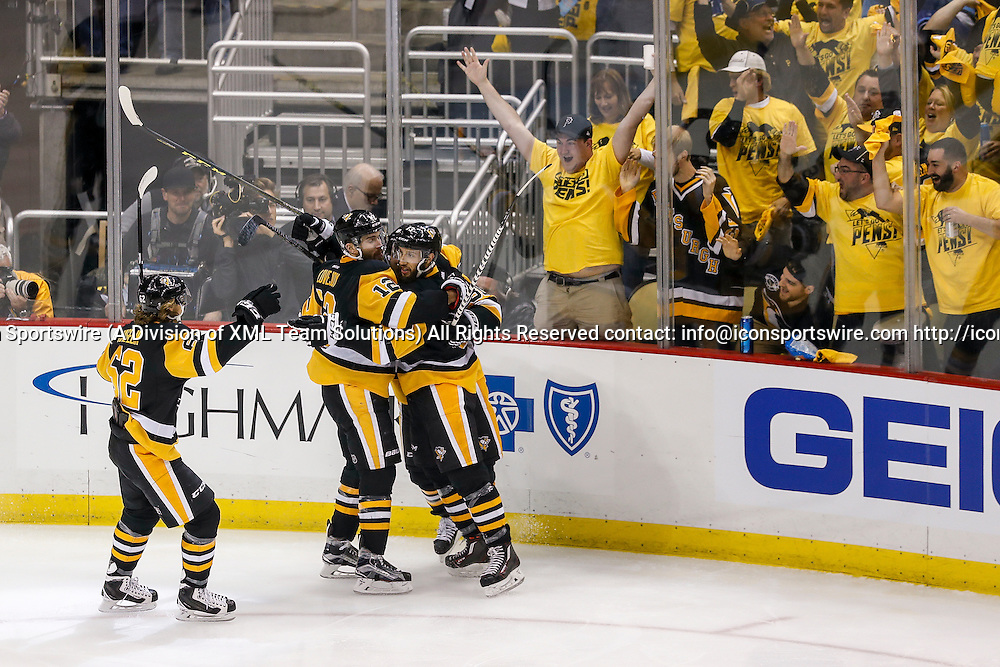 June 9, 2016:  Pittsburgh Penguins center Nick Bonino (13), Penguins teammates, and fans celebrate goal from Pittsburgh Penguins left wing Carl Hagelin (62) during the San Jose Sharks and Pittsburgh Penguins NHL Stanley Cup playoff game at Consol Energy Center in Pittsburgh, PA. San Jose defeated Pittsburgh 4-2. (Photo by John Crouch/Icon Sportswire).