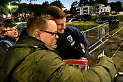 Chris Mepham (33) of AFC Bournemouth has a selfie with  a fan as he arrives at the Vitality Stadium before the Premier League match between Bournemouth and Chelsea at the Vitality Stadium, Bournemouth, England on 30 January 2019.