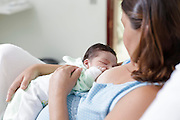 Goiania_GO, Brasil.<br /> <br /> Mae amamentando o filho.<br /> <br /> Mother breastfeeding her child.<br /> <br /> Foto: NIDIN SANCHES / NITRO
