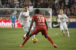 March 1, 2018 - Harrison, New Jersey, United States - New York Red Bulls midfielder ALEX MUYL (19) dribbles ball while defended by Club Deportivo Olimpia Defender JOHNNY PALACIOS (30) during the CONCACAF Champions league match at Red Bull Arena in Harrison, NJ.  NY Red Bulls defeat CD Olimpia 2-0  (Credit Image: © Mark Smith via ZUMA Wire)