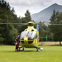 Helimed 76 the EC135 T2i Helicopter of Scotland's Charity Air Ambulance (SCAA) pictured after landing at Kinloch Rannoch with the backdrop of Schiehallion. Paramedics Daz O'Brien and Rich Garside are pictured boarding the helicopter before departing<br />Picture by Graeme Hart.<br />Copyright Perthshire Picture Agency<br />Tel: 01738 623350  Mobile: 07990 594431