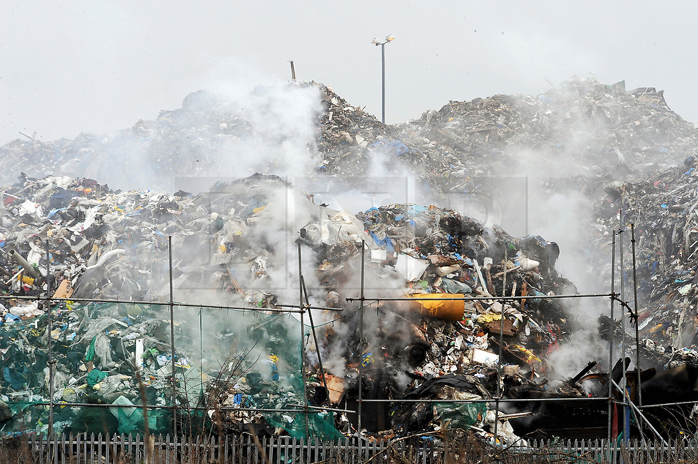 ©  London News Pictures. FILE PICTURE dated 21/03/2013. A fire burning at the Waste4Fuel site. An enormous pile of waste towering over properties on Cornwall Drive in St Pauls Cray, Bromley, South East London is the subject of a High Court Hearing due to take place today (Mon). The Environment Agency is seeking contempt charges against current and former directors of Waste4Fuel, the company that run the site,  over the fire risks caused by the mass of rubbish. The fire service has been called to the site on numerous occasion. Locals have also raised concerns about the health implications of living so close to the mass of waste. Photo credit: Grant Falvey/LNP