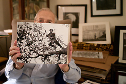 Photographer Phillip Taylor shows an photo as he assembles highlight from his decades long passion.