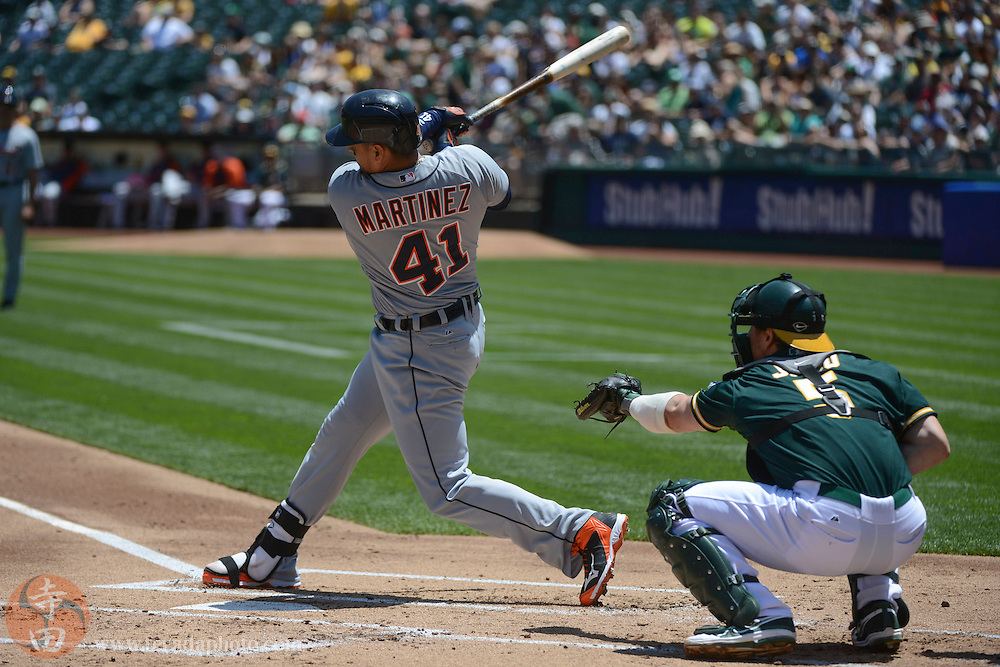 May 29, 2014; Oakland, CA, USA; Detroit Tigers designated hitter Victor Martinez (41) hits a single against the Oakland Athletics during the first inning at O.co Coliseum.