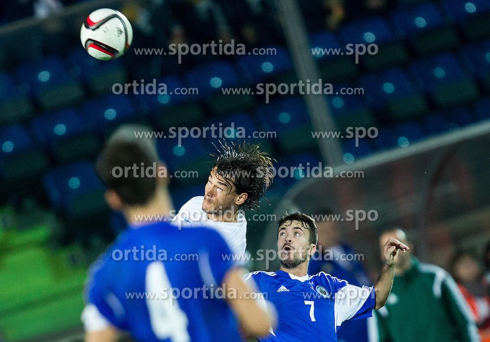 Rene Krhin of Slovenia vs Matteo Vitaioli of San Marino during football match between National teams of San Marino and Slovenia in Group E of EURO 2016 Qualifications, on October 12, 2015 in Stadio Olimpico Serravalle, Republic of San Marino. Photo by Vid Ponikvar / Sportida