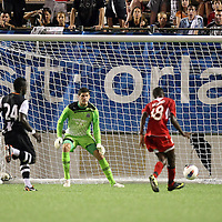 Orlando City Lions Midfielder Kevin Molino (18) scores a goal against Newcastle United Goalkeeper Fraser Forester (21) during an International Friendly soccer match between English Premier League team Newcastle United and the Orlando City Lions of the United Soccer League, at the Florida Citrus Bowl on Saturday, July 23, 2011 in Orlando, Florida. Orlando won the match 1-0. (AP Photo/Alex Menendez)