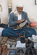 Cobbler at Friday market. Sanaa, Old City.