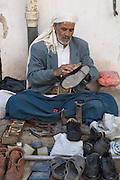 Cobbler at Friday market. Sanaa, Old City.