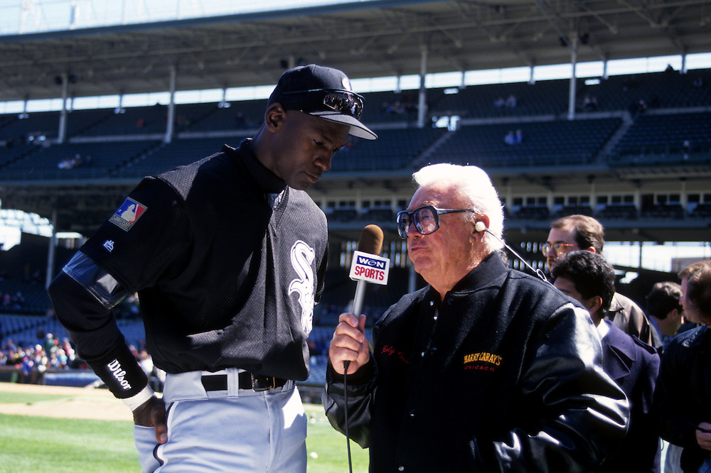 CHICAGO, IL-MARCH 1994:  NBA Hall of Famer Michael Jordan talks with broadcaster Harry Caray prior to an exhibition game between the Chicago White Sox and Chicago Cubs at Wrigley Field in Chicago Illinois in 1994.  (Photo by Ron Vesely)