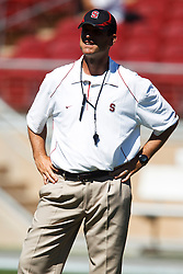 September 4, 2010; Stanford, CA, USA;  Stanford Cardinal head coach Jim Harbaugh watches his team warm up before the game against the Sacramento State Hornets at Stanford Stadium.