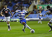 Aaron Tshibola threads a through ball during the Sky Bet Championship match between Reading and Derby County at the Madejski Stadium, Reading, England on 15 September 2015. Photo by David Charbit.
