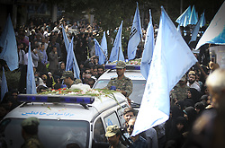 TEHRAN, Oct. 4, 2015 (Xinhua) -- Iranian people follow an ambulance carrying coffins of dead pilgrims during a funeral ceremony in downtown Tehran, Iran, on Oct. 4, 2015. Thousands of Iranians held ceremonies on Sunday to mourn their pilgrims who died in the latest Hajj stampede in Saudi Arabia on Sept. 24. The ceremonies were held in the capital, Tehran, and Iran's other cities to see off the dead bodies of 104 Iranian pilgrims that were transferred to Tehran on Saturday. . (Xinhua/Ahmad Halabisaz)(cl) (Credit Image: © Ahmad Halabisaz/Xinhua via ZUMA Wire)