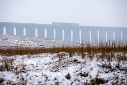 © Licensed to London News Pictures. 06/02/2018. Ingleton UK. A train can just be seen through the snow crossing the Ribblehead viaduct this morning in the Yorkshire Dales. Photo credit: Andrew McCaren/LNP