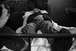 Resident of  house for an old released prisoners sleeps on his bed in barrack where he lives in a village Blagoveshenka, Kemerovo region, Eastern Siberia, Russia, 07 December 1999. Blagoveshensky house for an old former prisoners a special institution which is a part of a penitentiary system where live former prisoners which have age more then 55 years after released and haven't house or an apartment and relatives.