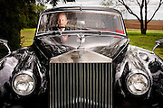 Photo by Gary Cosby Jr.  Rex Lindsey sits in his vintage Rolls Royce at his home in Limestone County.  Lindsey owns Affordable Vintage Autos.