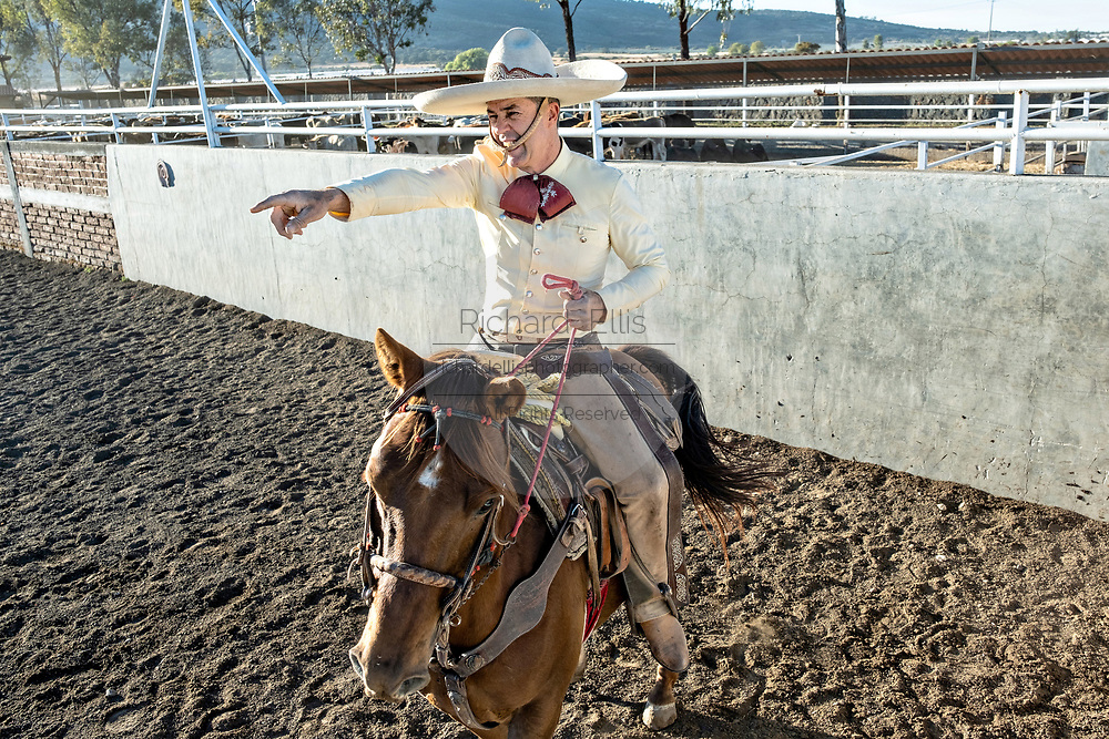 Juan Franco, Sr. on horseback at the family Charreria practice session in the Jalisco Highlands town of Capilla de Guadalupe, Mexico. The Franco family has dominated Mexican rodeo for 40-years and has won three national championships, five second places and five third places.