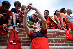 ANN ARBOR, USA - Friday, July 27, 2018: Liverpool's Andy Robertson takes a selfie with a supporter's iPhone after a training session ahead of the preseason International Champions Cup match between Manchester United FC and Liverpool FC at the Michigan Stadium. (Pic by David Rawcliffe/Propaganda)