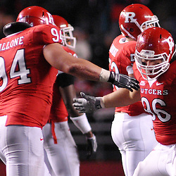 Oct 16, 2009; Piscataway, NJ, USA; Rutgers defensive tackle Scott Vallone (94) and defensive tackle Charlie Noonan (96) celebrate a defensive stop during second half NCAA football action in Pittsburgh's 24-17 victory over Rutgers at Rutgers Stadium.