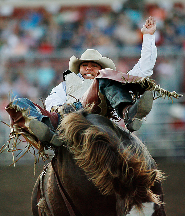 John Havens of Prineville, Ore., rides Spy Friday night during the Bareback Riding competition at the 2008 Horse Heaven Round-Up Rodeo.