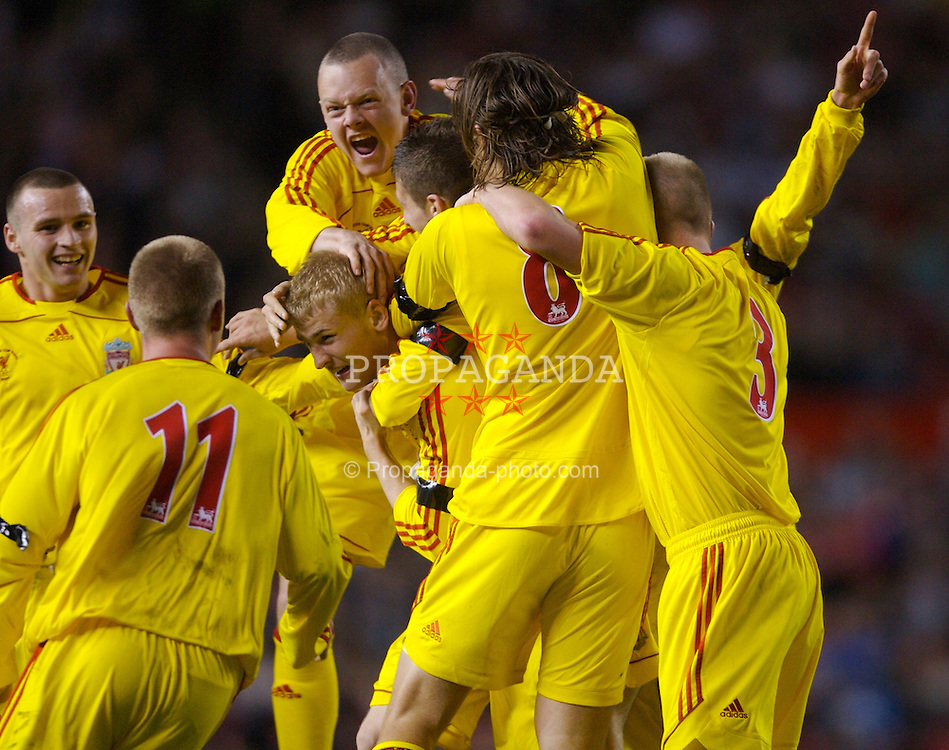 Manchester, England - Thursday, April 26, 2007: Liverpool's Robbie Threlfall (c) is mobbed by team-mates as he celebrates scoring the opening goal against Manchester United to level the tie 2-2 during the FA Youth Cup Final 2nd Leg at Old Trafford. L-R: Jimmy Ryan, Ray Putterill, Robbie Threlfall, captain Jay Spearing, Craig Lindfield, Astrit Ajdarevic and Michael Burns. (Pic by David Rawcliffe/Propaganda)
