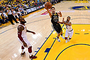 June 3, 2018; Oakland, CA, USA; Golden State Warriors guard Klay Thompson (11) shoots the ball against Cleveland Cavaliers guard George Hill (3) during the first quarter in game two of the 2018 NBA Finals at Oracle Arena.