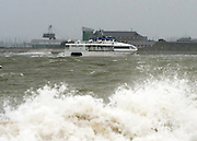 © Licensed to London News Pictures. 11/11/2014. Southsea, UK. Boats battle with choppy seas.  Wet and windy weather today, 11 November 2014, at Southsea, Portsmouth. The Met Office have issued weather warnings in some parts of the UK. Photo credit : Stephen Simpson/LNP