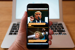 Using iPhone smartphone to display homepage of Sputnik Russian , English language, news propaganda media outlet