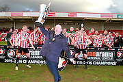 Kyle Storer, Gary Johnson and Aaron Downes and the Cheltenham team celebrate the championship after the Vanarama National League match between Cheltenham Town and Lincoln City at Whaddon Road, Cheltenham, England on 30 April 2016. Photo by Antony Thompson.