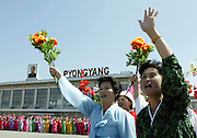North Koreans wave flowers as South Koreans arrive at Sunahn airport in North Korea's capital Pyongyang. Photo by Lee Jae-Won (NORTH KOREA) www.leejaewonpix.com