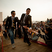 Hong Kong actor Aaron Kwok, star of the film 'Cold War', touches the hands of fans as he leaves an outdoor greeting event at Haeundae BIFF Village on Friday, October 5, 2012.