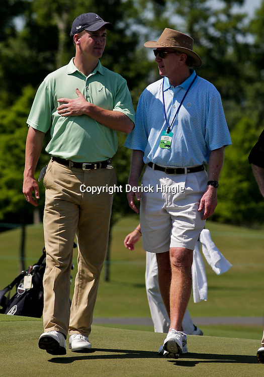 2009 April 22: Peyton Manning quarterback of the NFL's Indianapolis Colts walks with his father form New Orleans Saints quarterback Archie Manning during the PGA Tour, Zurich Classic of New Orleans Classic Pro-Am played at TPC Louisiana in Avondale, Louisiana.