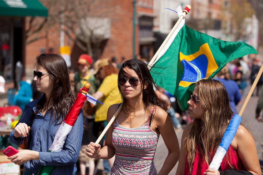 Brazilians Sabrina Oliveira, left, Amanda Diniz, center and Fabiana Sandes tour the street fair which closed out the celebration of International Week at Ohio University.  Photo by Ohio University / Jonathan Adams