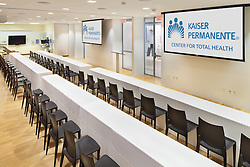 Kaiser Permanente Conference room set up with tables and chairs