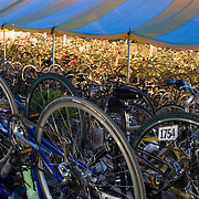 Hundreds of bicycles belonging to Trekkers stand underneath a large yellow and white tent. The 2007 Trek Across Maine, an annual project of the American Lung Association of Maine (ALAM).