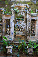The wall of an inside courtyard in Quan Thang House in Hoi An, Vietnam