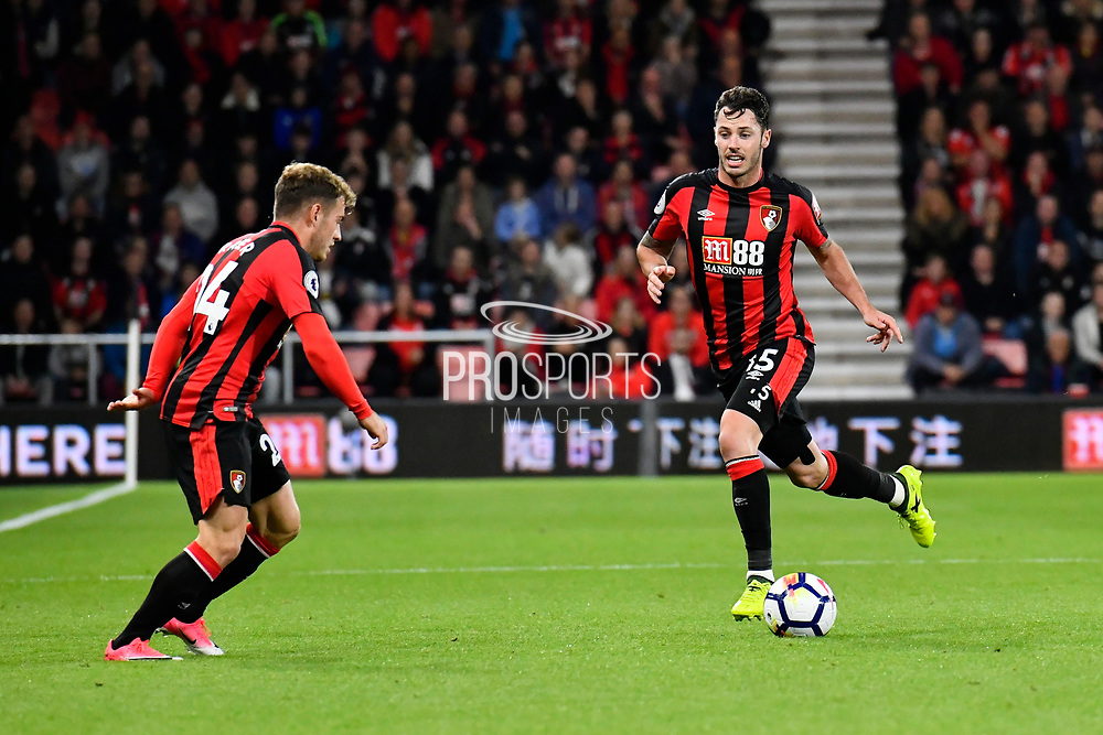 Ryan Fraser (24) of AFC Bournemouth and Adam Smith (15) of AFC Bournemouth link up during the Premier League match between Bournemouth and Brighton and Hove Albion at the Vitality Stadium, Bournemouth, England on 15 September 2017. Photo by Graham Hunt.