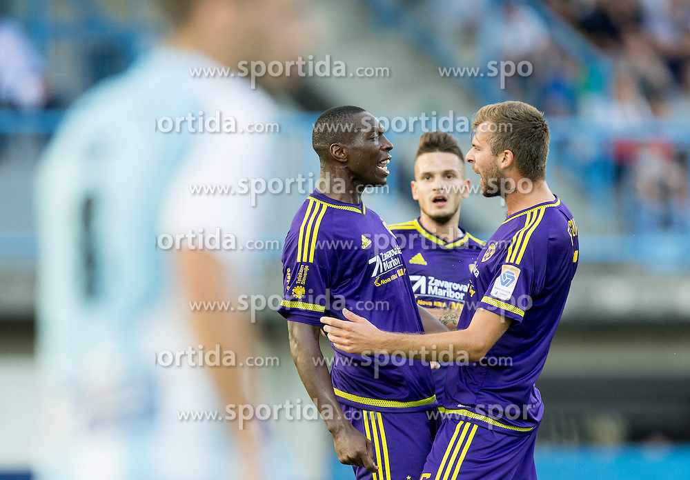 Jean Philippe Mendy #14 of Maribor and Zeljko Filipovic #5 of Maribor celebrate after Meny scored first goal for Maribor during football match between ND Gorica and NK Maribor in 9th Round of Prva liga Telekom Slovenije 2015/16, on September 12, 2015, in Sports centrum Nova Gorica, Slovenia. Photo by Vid Ponikvar / Sportida