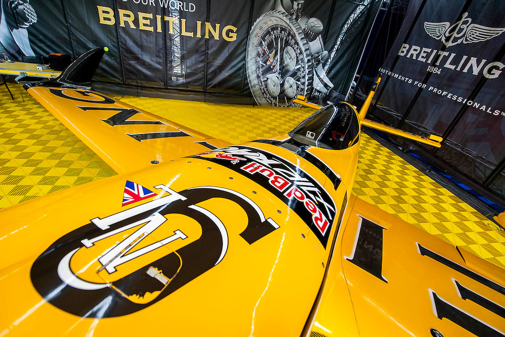The Breitling plane of Nigel Lamb (UK, who came second) is inspected in the 'pit lane' - Red Bull Air Race World Championships at Ascot Race Course. A combination of high speed, low altitude and extreme manoeuvrability make it only accessible to the 'world's most exceptional pilots'. 12 pilots compete in the Master Class category in eight races across the globe for the title of 2014 Red Bull Air Race World Champion. The objective is to navigate an aerial racetrack featuring air-filled pylons in the fastest possible time, incurring as few penalties as possible. All 12 pilots race with a standardised propulsion package – a high-performance, race-tuned standardised engine (Lycoming Thunderbolt) and standardised propellers (Hartzell 3-bladed). They do have a chooice of 3 single engine/seater aircraft - the Zivko Aeronautic Edge 540, the MXS-R and the Hungarian University of Aviation's Corvus Racer 540 - all cappable of around 230kts and of surviving high G forces, 10+. A new feature of the 2014 Red Bull Air Race World Championship is the debut of the new Challenger Cup, giving a new generation of talented pilots from around the world a chance to race. Entertainement is provided by the Red Arrows and the Breitling Wingwalkers, amongst others.  Ascot Racecourse, High St, Ascot, Berkshire, UK.