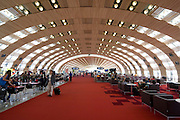 Terminal 2E, Paris Charles de Gaulle Airport, designed by Paul Andreu. ....On 23 May 2004, not long was inaugurated, part of Terminal 2E's ceiling collapsed, near Gate E50, killing four people. Apparently the whole building chain had worked as close to the limit as possibl to reduce costs.  Desaigner Paul Andreu denounced the building companiesfor failing to correctly prepare the reinforced concrete...