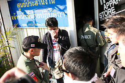 © Licensed to London News Pictures. 17/01/2014. Police enter the apartment alledgley housing the suspect whom threw an explosive device injuring eight people during an anti-government street rally on January 17, 2014 in Bangkok, Thailand. Anti-government protesters launch 'Bangkok Shutdown', blocking major intersections in the heart of the capital, as part of their bid to oust the government of Prime Minister Yingluck Shinawatra ahead of elections scheduled to take place on February 2. Photo credit : Asanka Brendon Ratnayake/LNP