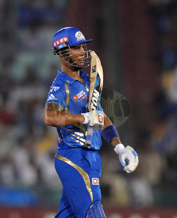Lendl simmons of Mumbai Indians gestures towards the team dug out after scoring a hundred run partnership with Michael Hussey of Mumbai Indians during the qualifier 4 match of the Oppo Champions League Twenty20 between the Mumbai Indians and the Southern Express held at the Chhattisgarh International Cricket Stadium, Raipur, India on the 14th September 2014<br /> <br /> Photo by:  Pal Pillai / Sportzpics/ CLT20<br /> <br /> <br /> Image use is subject to the terms and conditions as laid out by the BCCI/ CLT20.  The terms and conditions can be downloaded here:<br /> <br /> http://sportzpics.photoshelter.com/gallery/CLT20-Image-Terms-and-Conditions-2014/G0000IfNJn535VPU/C0000QhhKadWcjYs