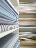 Piles of cotton fabric on shelfs