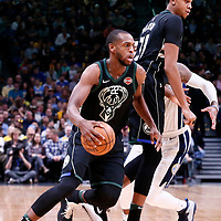 01 April 2018: Milwaukee Bucks forward Khris Middleton (22) drives past Denver Nuggets guard Torrey Craig (3) on a screen set by Milwaukee Bucks center John Henson (31) during the Denver Nuggets 128-125 victory over the Milwaukee Bucks, at the Pepsi Center, Denver, Colorado, USA.