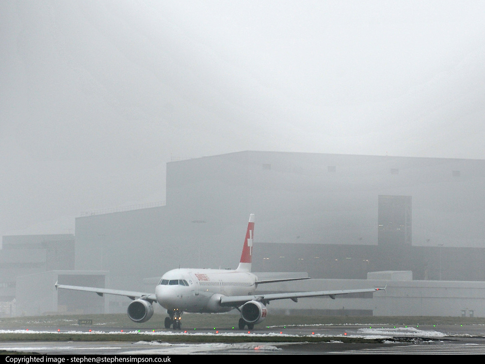 © Licensed to London News Pictures. 06/02/2012, Heathrow, UK. A plane taxis for take off in fog. Snow and heavy fog continue to disrupt flights at Heathrow Airport today 6th February 2012. Heavy snow fell over many parts of the South East of the UK over Saturday night.  Photo credit : Stephen Simpson/LNP