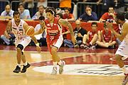 DESCRIZIONE : Milano  Lega A 2011-12 EA7 Emporio Armani Milano Scavolini Siviglia Pesaro play off semifinale gara 2<br /> GIOCATORE : Daniel Hackett<br /> CATEGORIA : contropiede palleggio<br /> SQUADRA : Scavolini Siviglia Pesaro<br /> EVENTO : Campionato Lega A 2011-2012 Play off semifinale gara 2 <br /> GARA : EA7 Emporio Armani Milano Scavolini Siviglia Pesaro<br /> DATA : 31/05/2012<br /> SPORT : Pallacanestro <br /> AUTORE : Agenzia Ciamillo-Castoria/ GiulioCiamillo<br /> Galleria : Lega Basket A 2011-2012  <br /> Fotonotizia : Milano  Lega A 2011-12 EA7 Emporio Armani Milano Scavolini Siviglia Pesaro play off semifinale gara 2<br /> Predefinita :