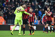 Asmir Begovic (27) of AFC Bournemouth and Steve Cook (3) of AFC Bournemouth celebrate the 2-1 win over Arsenal at full time during the Premier League match between Bournemouth and Arsenal at the Vitality Stadium, Bournemouth, England on 14 January 2018. Photo by Graham Hunt.