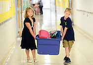 LOWER SOUTHAMPTON, PA - AUGUST 28:   Stephanie Peters, 7 and Ben Long, 8 carry their second grade class lunches to the cafeteria at the start of the first full day of school at Lower Southampton Elementary School August 28, 2014 in Lower Southampton, Pennsylvania. (Photo by William Thomas Cain/Cain Images)